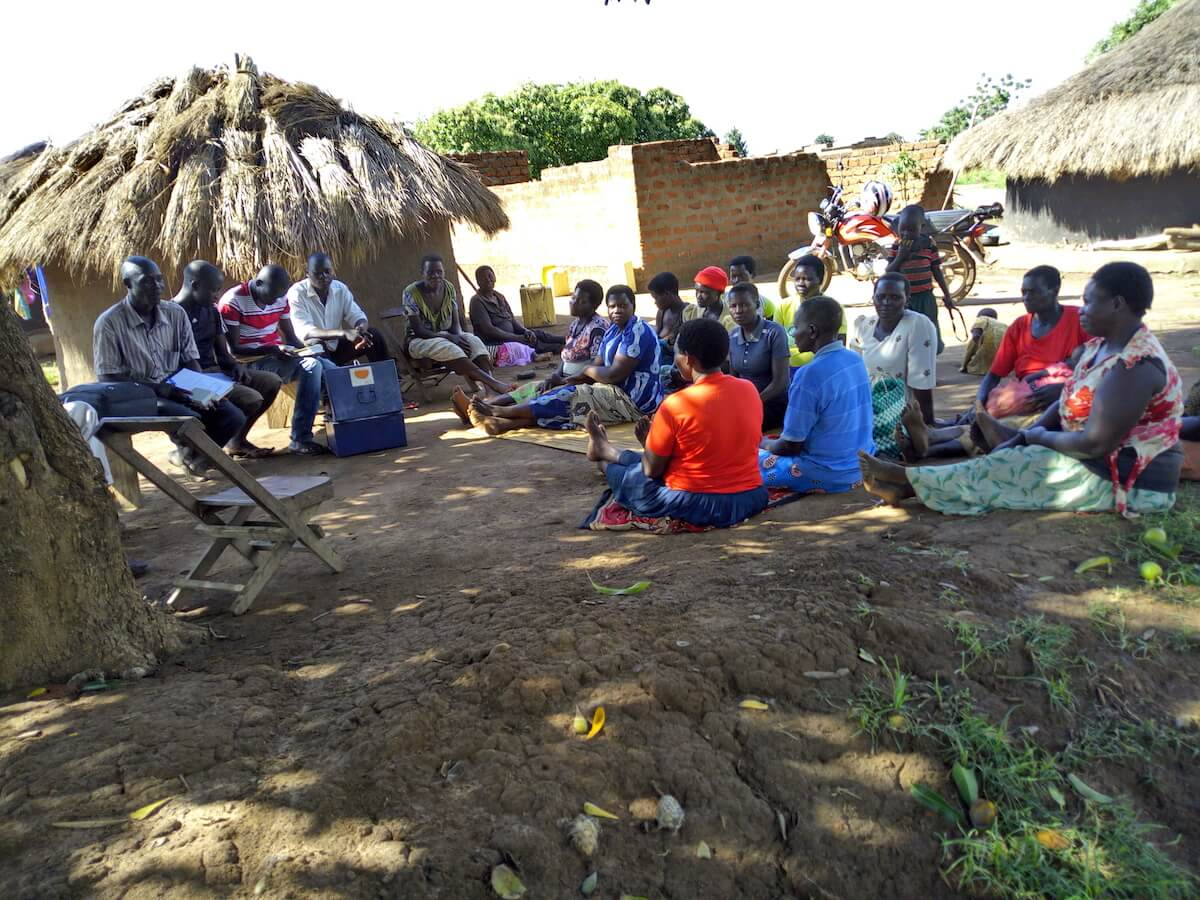 A VSLA meeting, members save money weekly while others take loans used to improve on their livelihoods