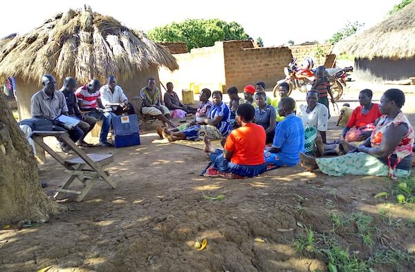 Link to Progress_a VSLA meeting, members save money weekly while others take loans used to improve on their livelihoods